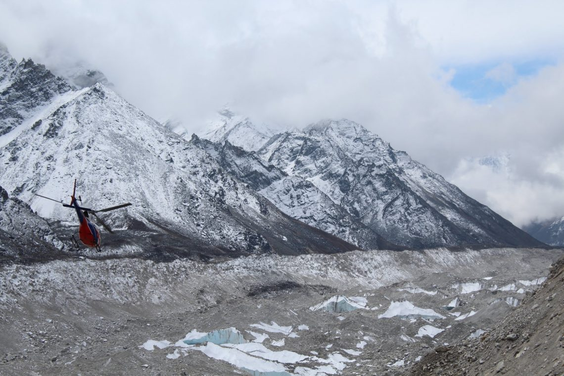Helicopter flies from Everest Base Camp.