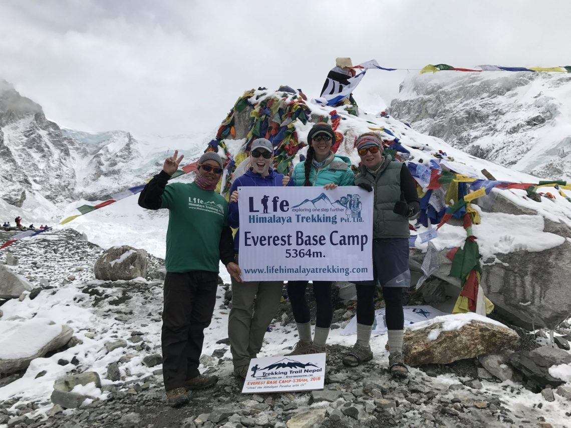 Trekkers celebrating after making it to Everest Base Camp with Life Himalaya Trekking.