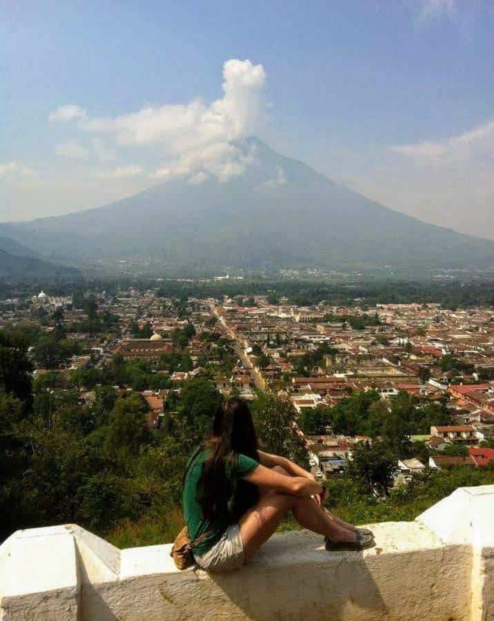 A traveler looks out of Antigua, Guatemala.
