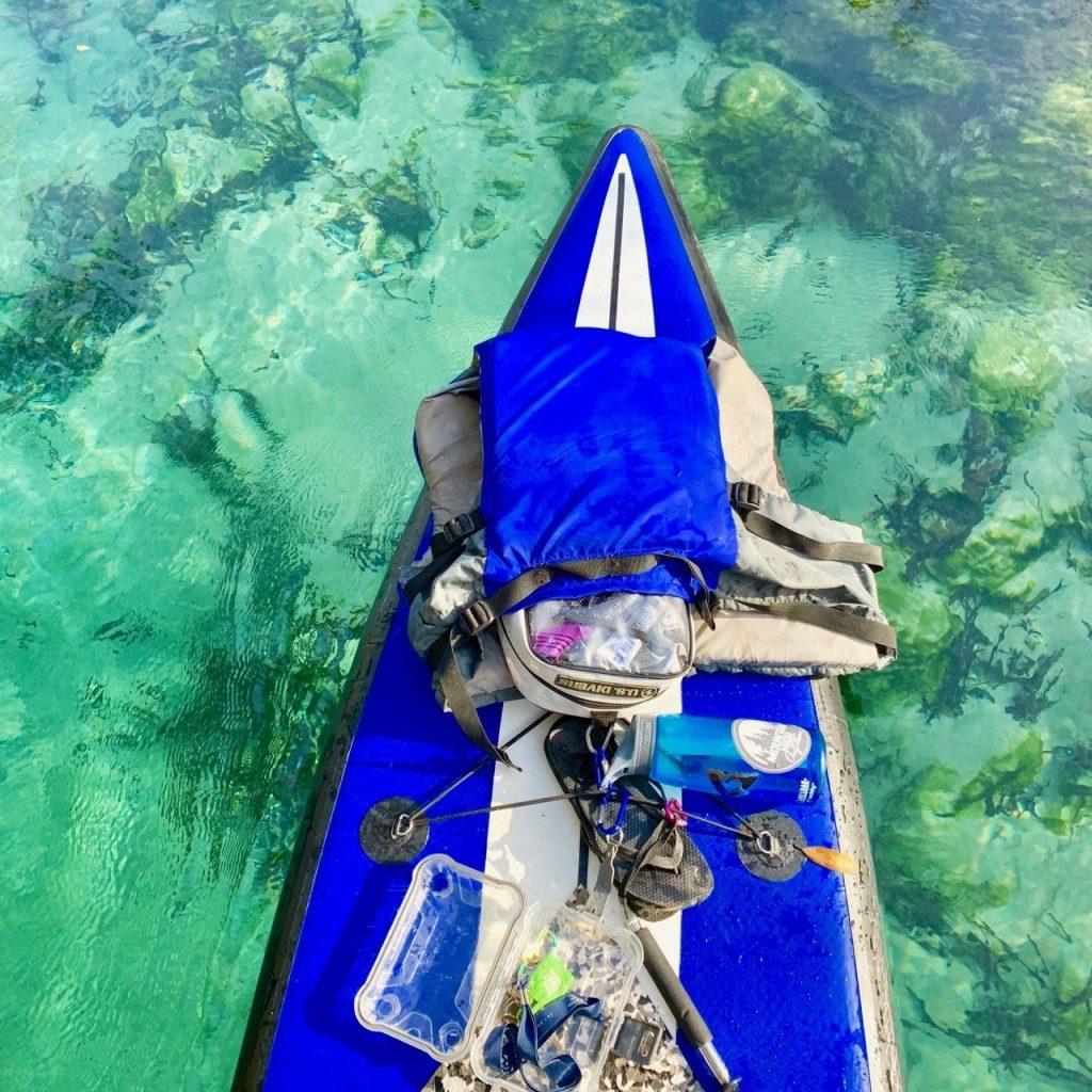 Gear secured on paddle board while kayaking Weeki Wachee Springs.
