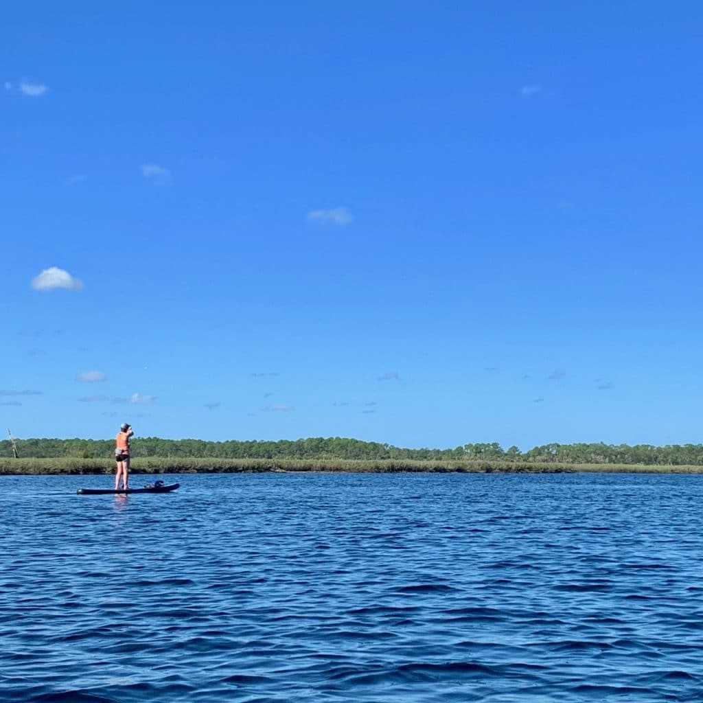 A paddler kayaking Tomoka State Park.