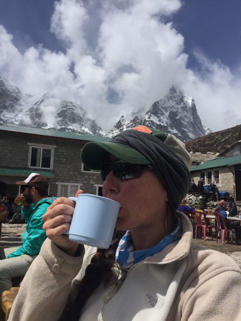 Hiker drinking coffee.