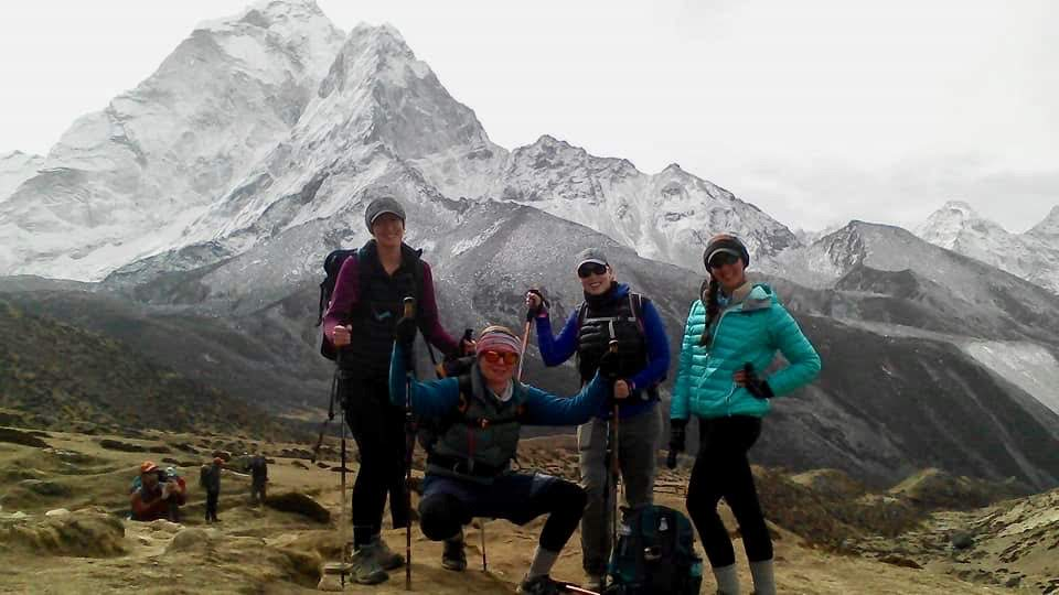 Hikers posing for a photo along the Everest Base Camp trekking route.