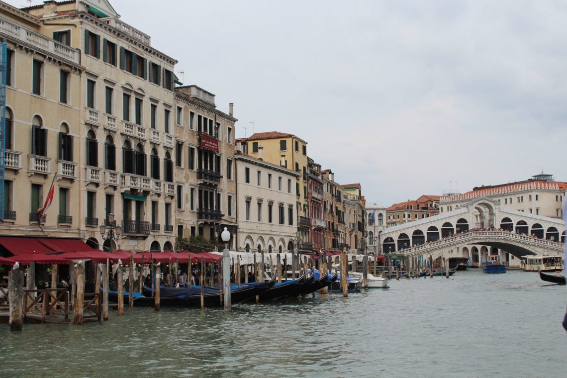A view from the Grand Canal overlooking the Rialto Bridge in Venice, Italy.