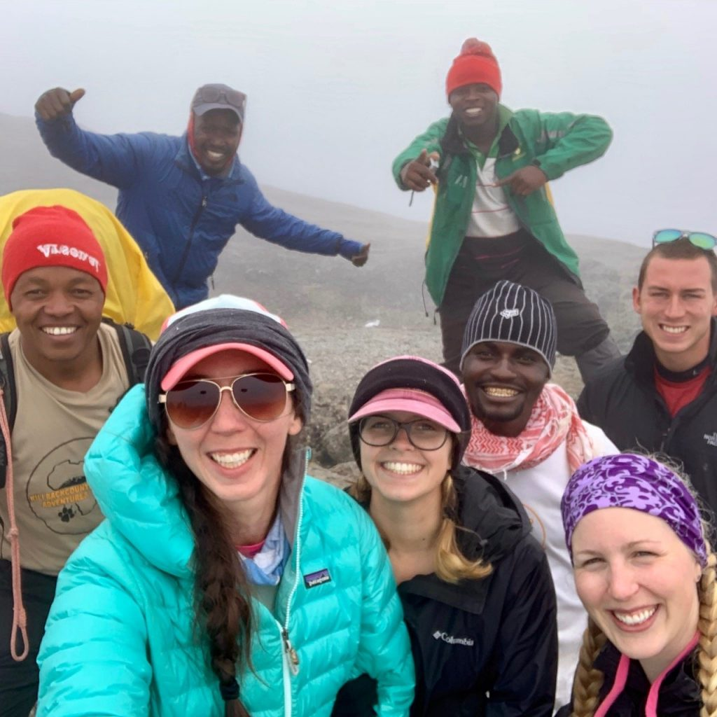 A group selfie after reaching the top of the Barranco Wall with our guides from Kilimanjaro Backcountry Adventures.