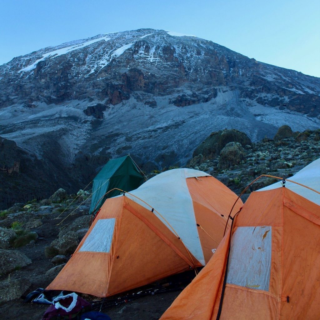 Two tents set up with Kilimanjaro in the background.