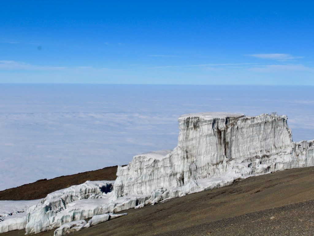 Glaciers on top of Kilimanjaro and above the clouds.