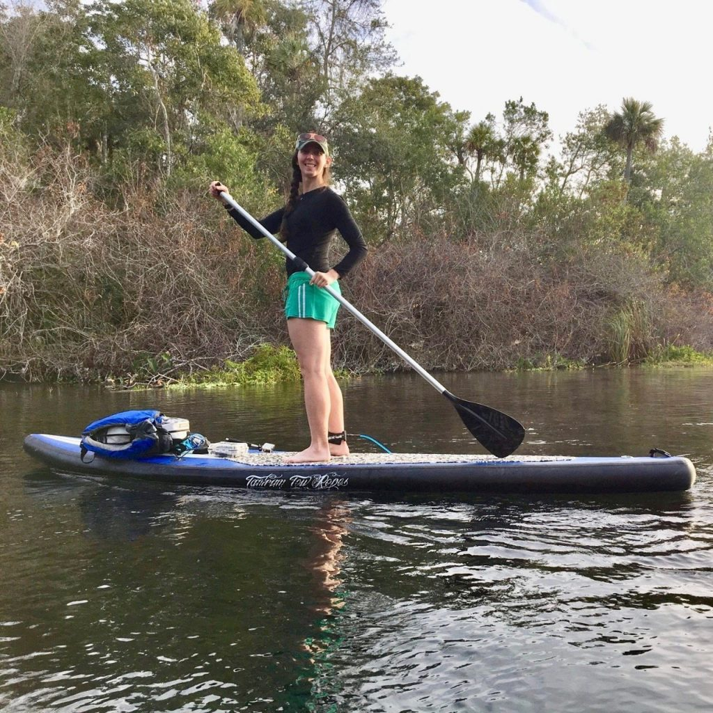 A paddler shows off her inflatable paddle board.