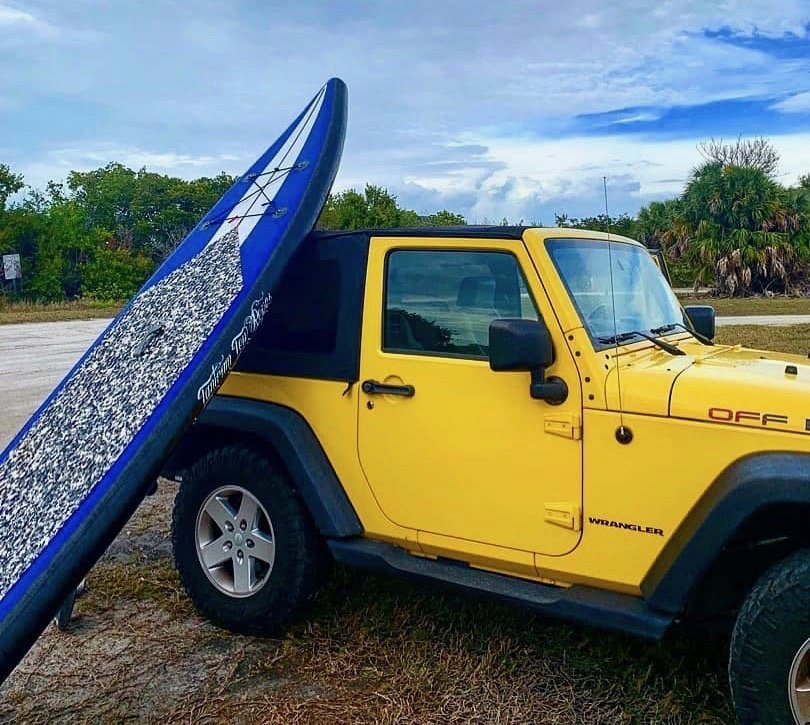 Popping my paddle board up to dry on my Jeep after paddling along the waterways of Fort DeSoto.