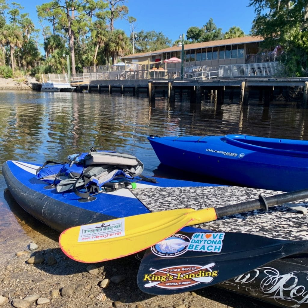 A couple of kayaks and paddle boards are ready to launch into the Tomoka River just outside of the Tomoka Outpost.
