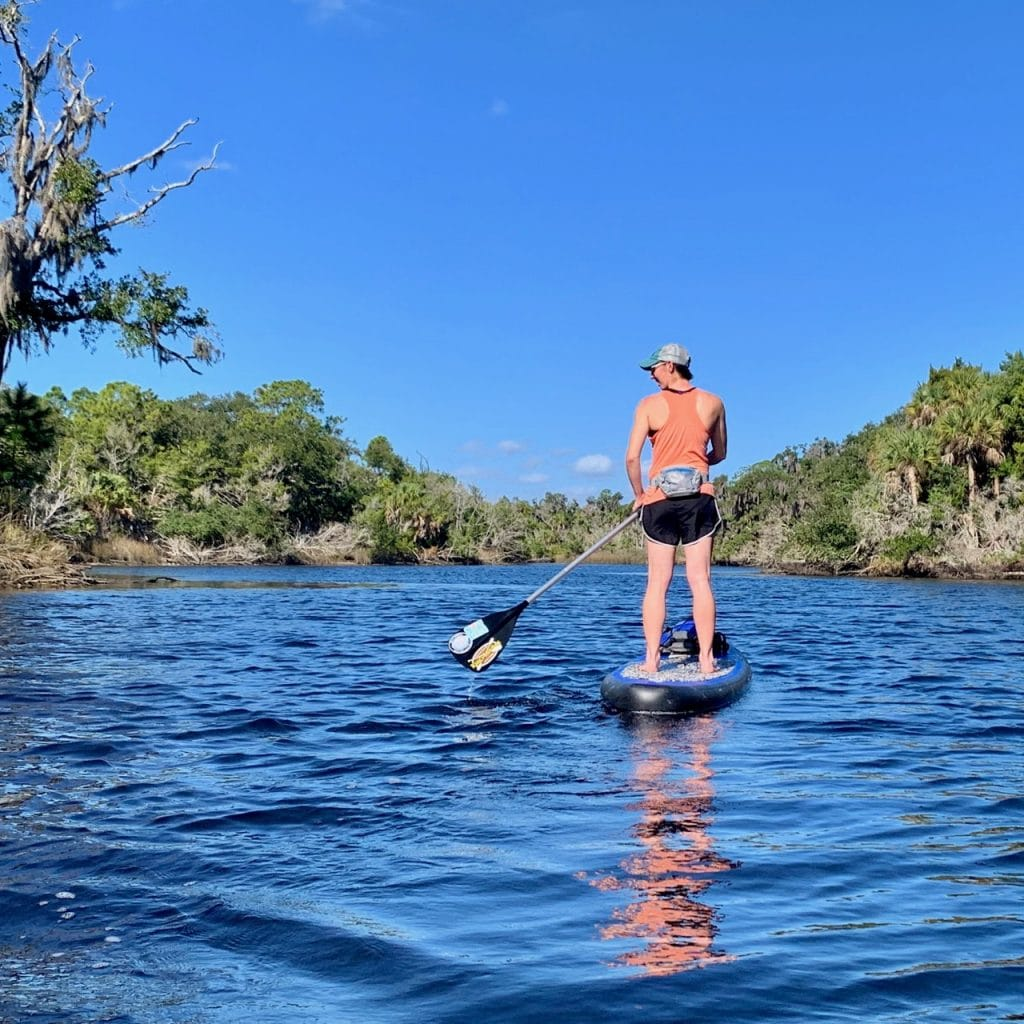 A paddler kayaking Tomoka State Park.